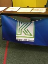 KMTA's logo on new banner at registration desk.