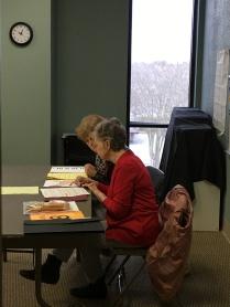 Teachers organizing test papers.